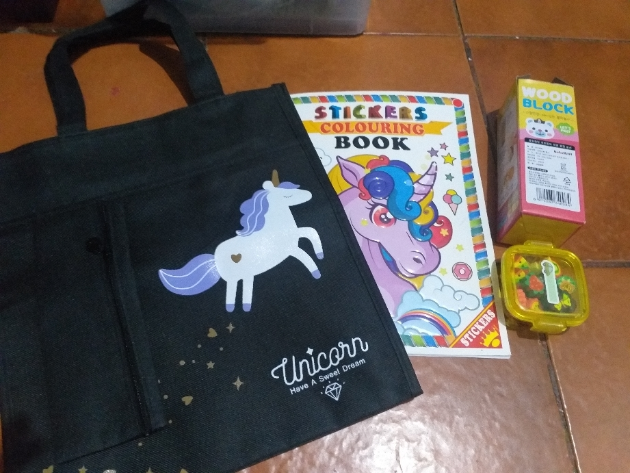 Unicorn coloring book with striker