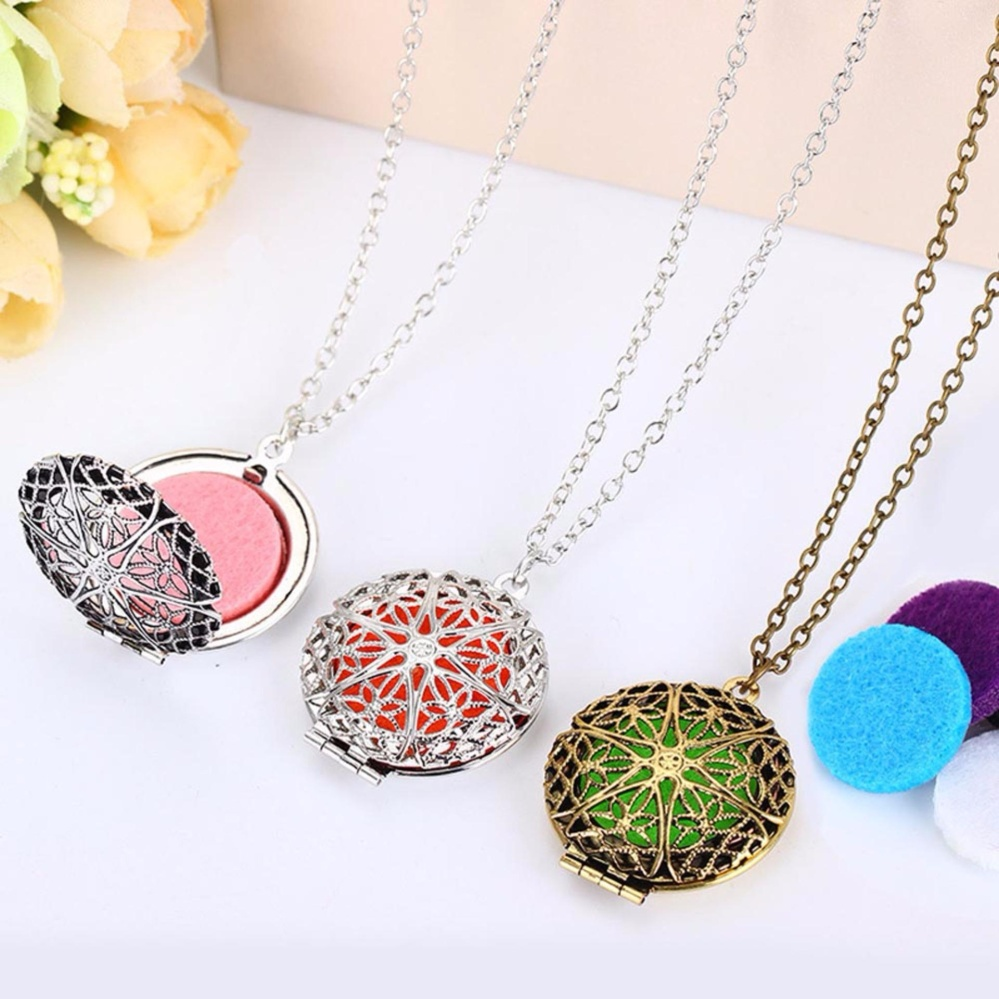 Fancyqube round locket aromatherapy locket pendant necklace round fancyqube round locket aromatherapy locket pendant necklace round hollow out star shaped essential oils diffuser bronze mozeypictures Choice Image